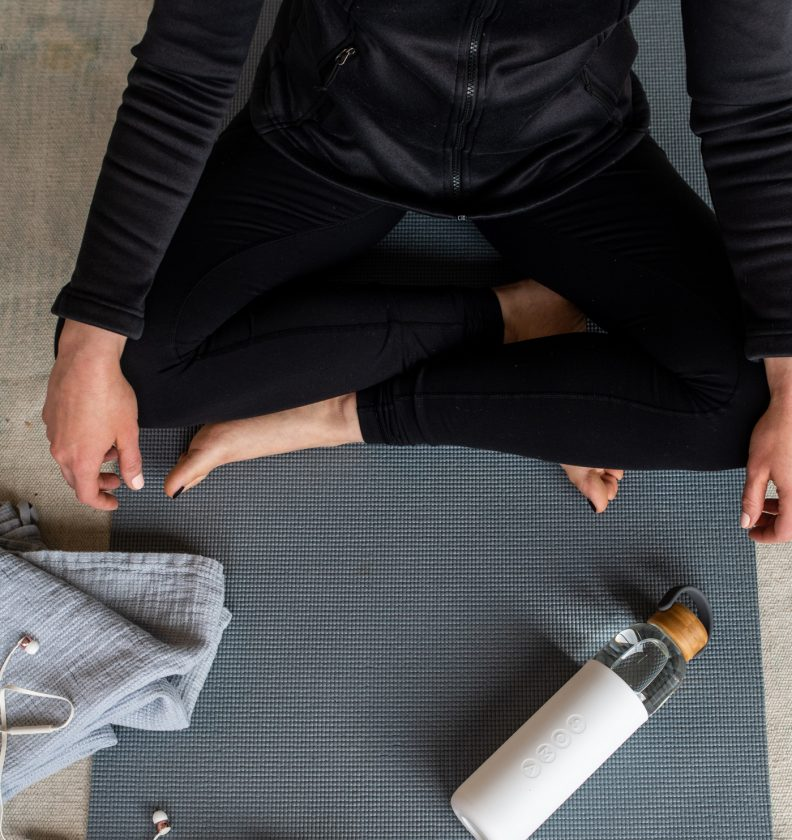 Bower woman sitting on the yoga mat