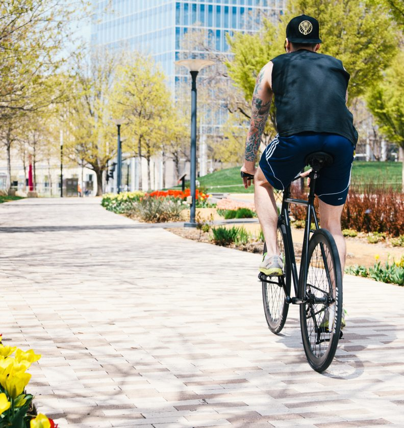 man on bicycle in the park